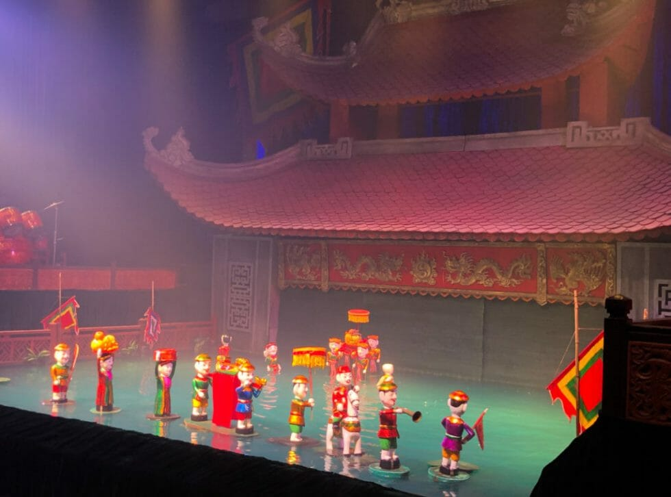 You must attend a water puppet show in Vietnam with kids