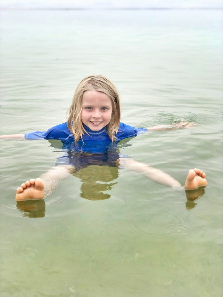 Floating in the Dead sea is a fun thing to do in Israel with kids